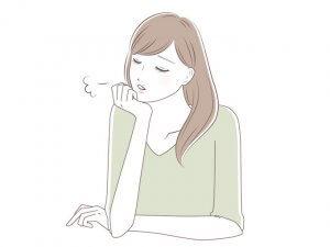 体の不調で悩む女性のイメージ